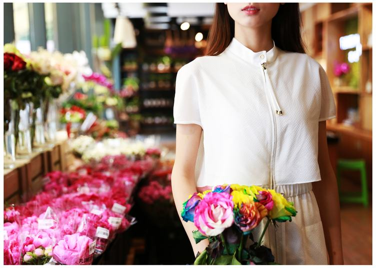 Woman in Florist Holding Colorful Roses