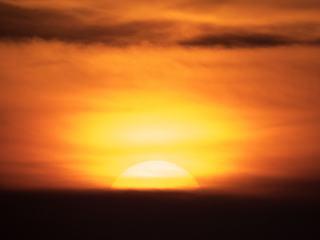 Sunset Big Yellow Sun on Orange Sky