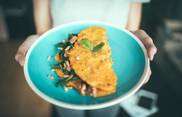Closeup of Blue Plate with Delicious Omelette