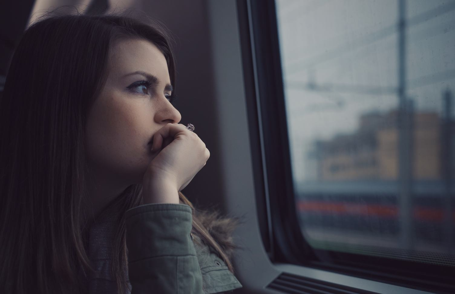 Girl Looking Out the Window Sitting at Train