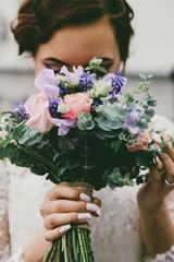 Nice Colorful Wedding Bouquet in Bride's Hand