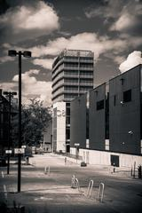 Black & White Photo of Buildings and Parking