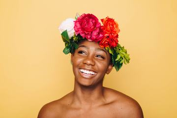 Smiling Woman with Flower Werth and Bare Shoulders