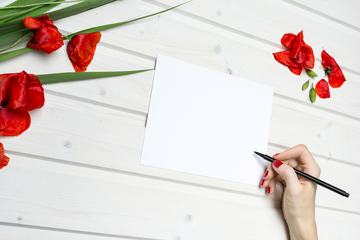 Woman Writing Wishes on the Blank Card