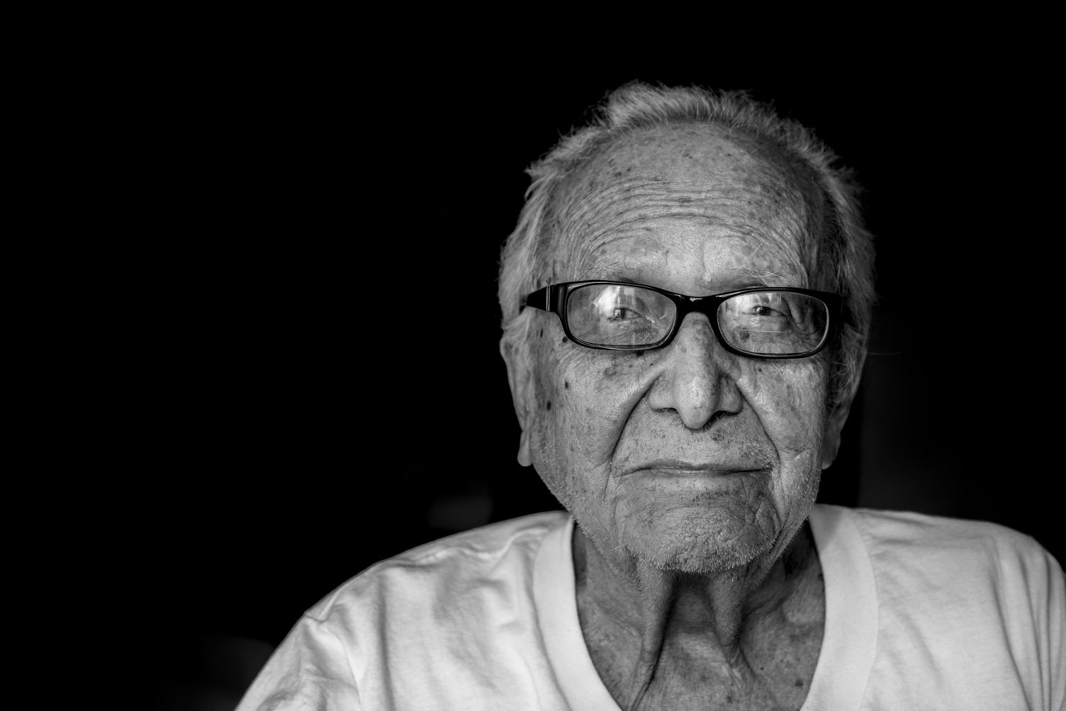 Black & White Portrait of Old Man Wearing Glasses