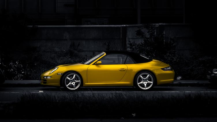 Free Photo Yellow Porsche On Dark Background Expensive Car