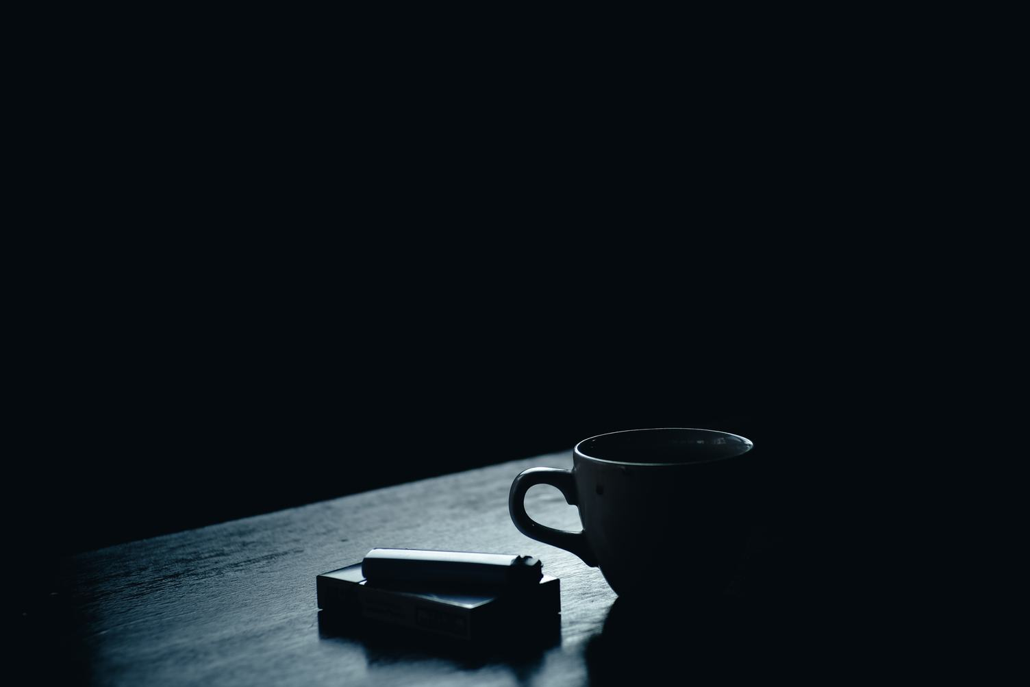 A Pack of Cigarettes and Coffee on the Table