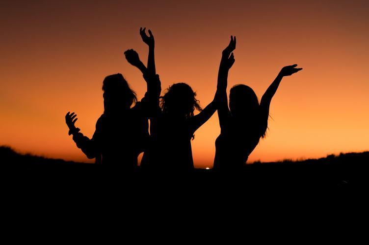 Silhouette of Three Happy Women
