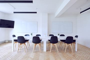 Empty Conference Room, White Tables and Black Chairs