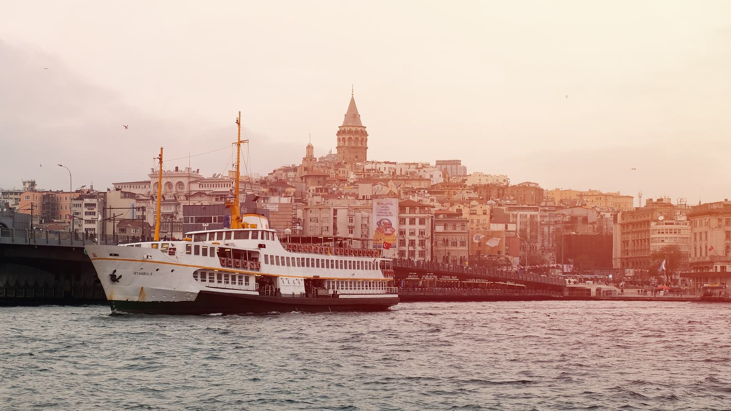 Tourist Ship in Istanbul View on Galata Bridge and Tower
