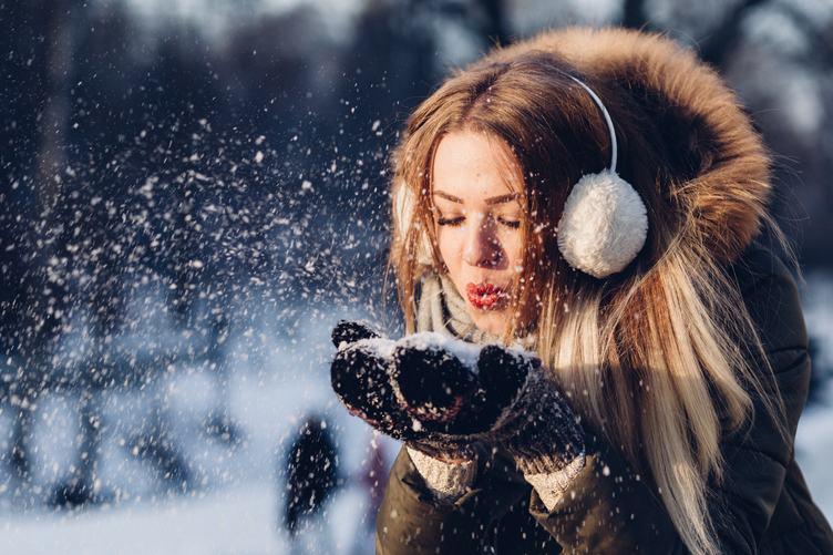 Young Woman Blowing Snow, Magic Snowfall Effect