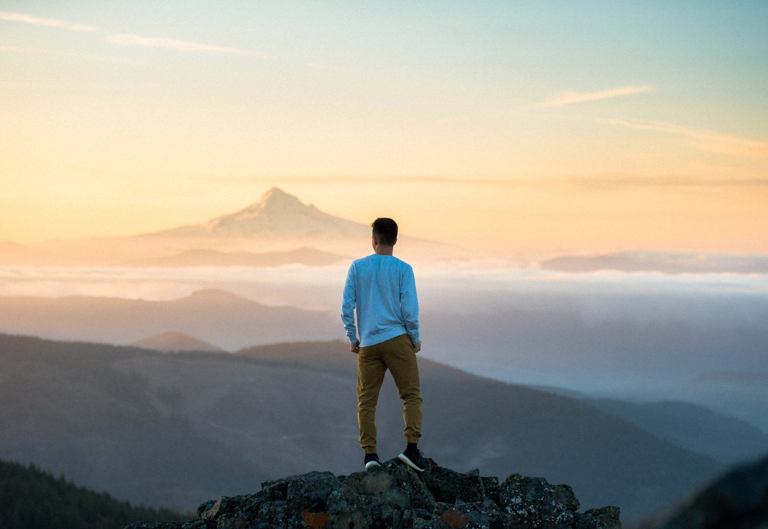 Man Standing on a Peak and Admire the Views