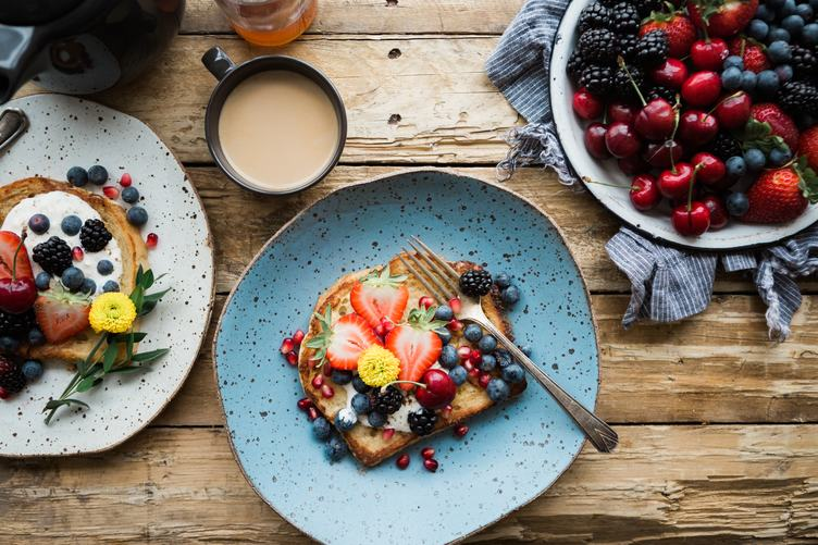 Sweet Breakfast Toast with Fruits on Wooden Table
