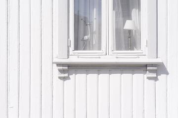 White Wall of an Old Wooden House with Window