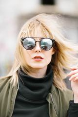 Portrait of Young Beautiful Blonde Girl in Sunglasses
