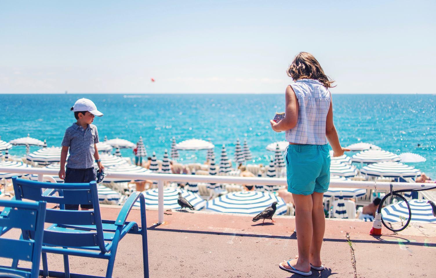 Summer Vacation Children Feeding Pigeons on the Beach