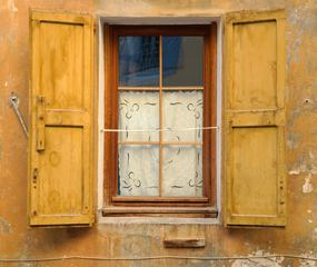 Old Window with Yellow Shutters