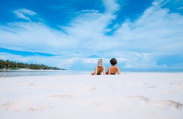 Beautiful Tropical Landscape Young Couple Lying on a Beach