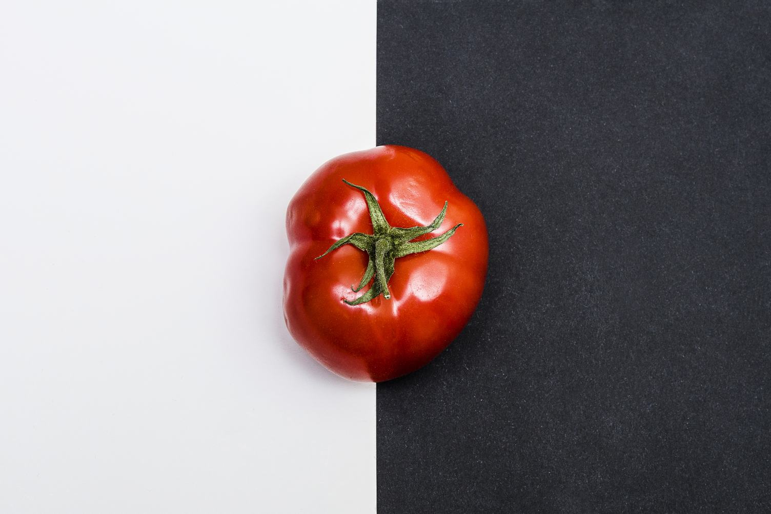 Ripe Tomato on Black and White Background Top View