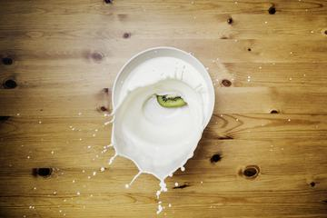 Milk Splash on Wooden Background