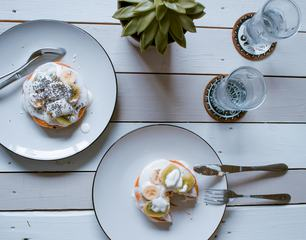 Pancakes with Yoghurt, Kiwi and Banana on Wooden Background Top View