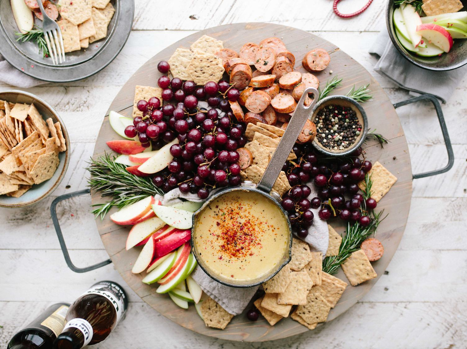 Fruits and Cheese Plate Antipasti Snacks on Wooden Board