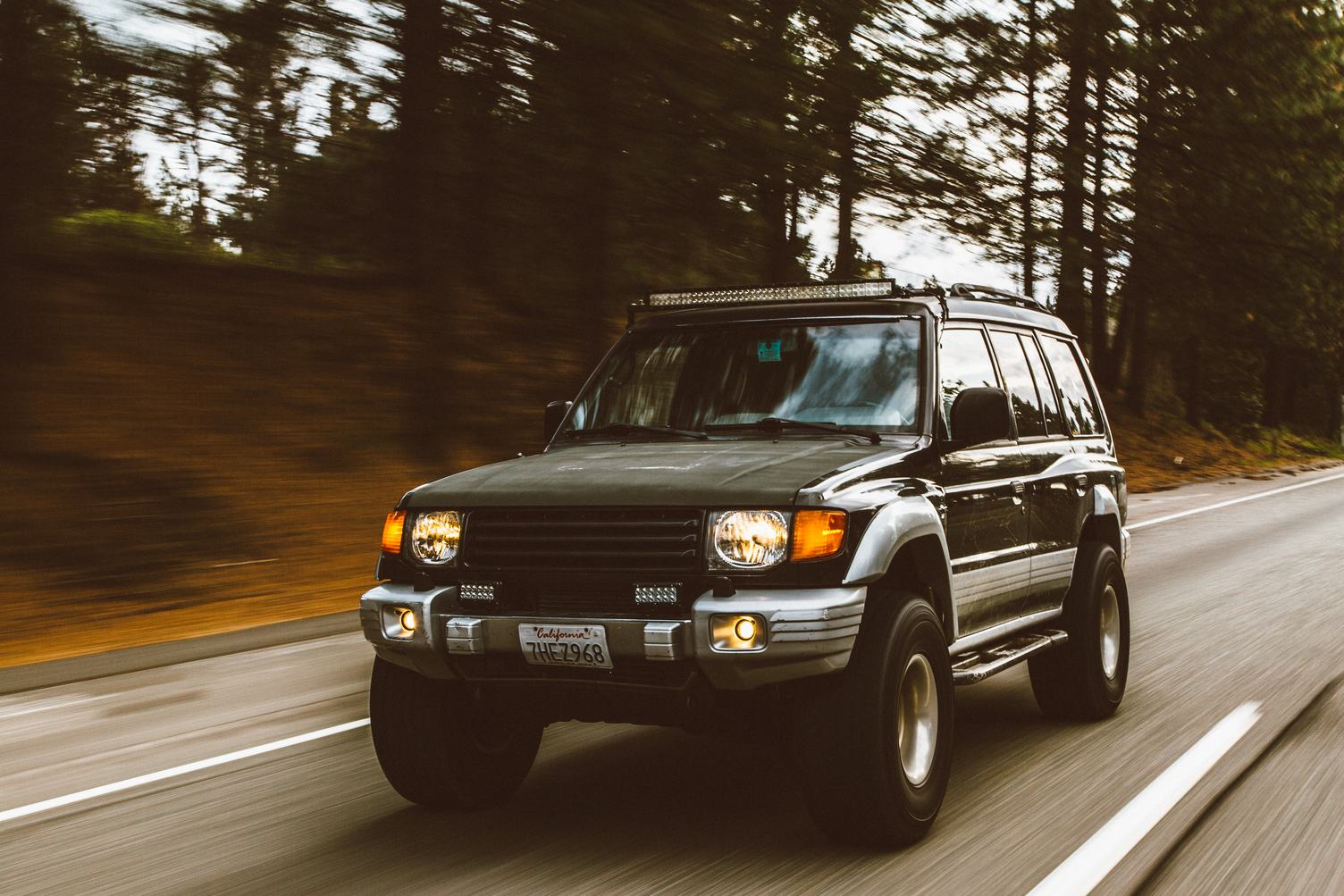 Motion Blur Shot of SUV on the Road