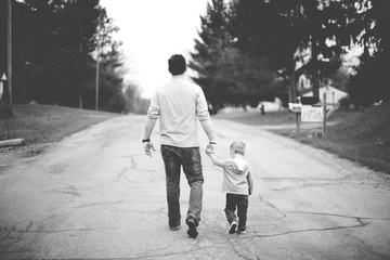 Father and Little Boy Walking Down the Street