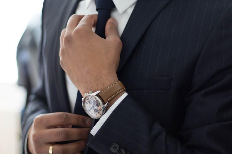 Businessman Adjust Necktie His Suit