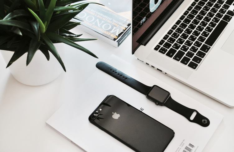 Laptop, Smartphone and Watch on White Table