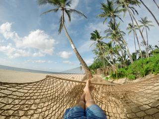 Lazy Time Man in a Hammock on the Beach