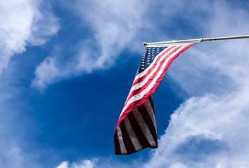Flag of the United States on the Blue Sky