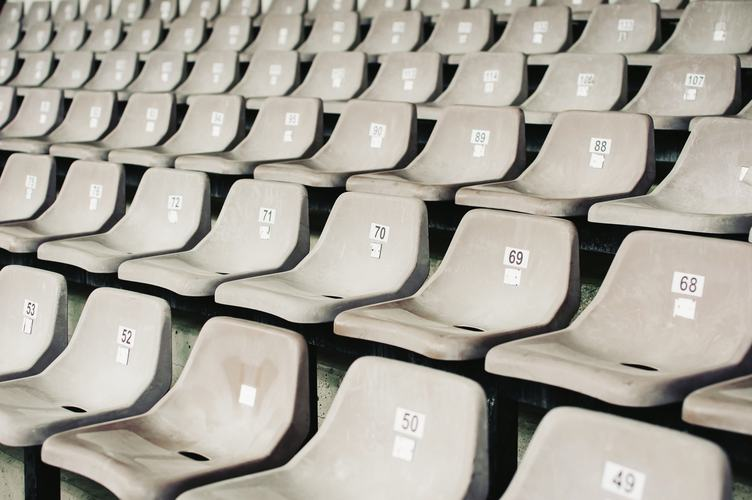 Numbered Gray Seats in a Stadium