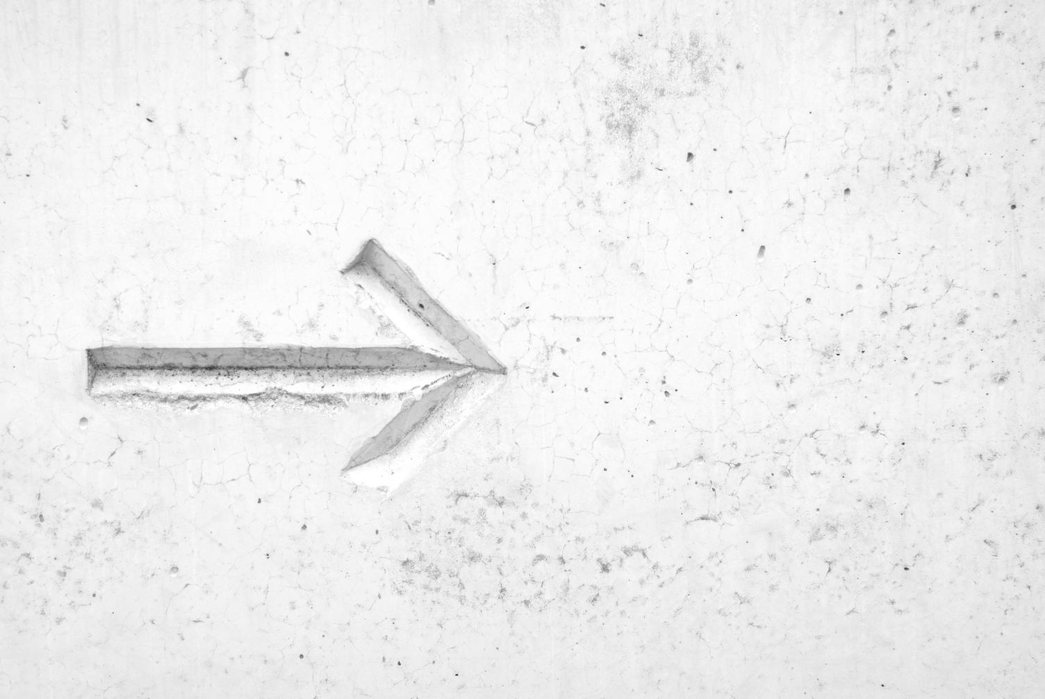 This Way - Arrow on Concrete Wall