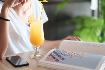 Woman Drinking Cocktail in a Cafe