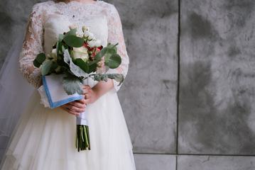Bride in White Dress with Bouquet of Flowers