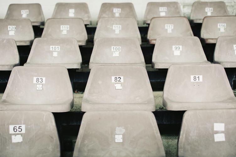 Empty Plastic Gray Chairs at the Stadium