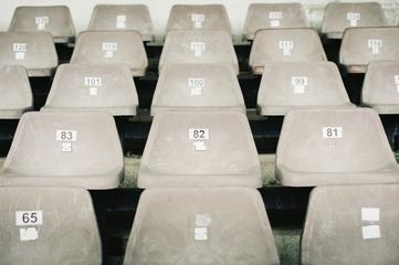 Empty Plastic Gray Chairs at the Stadium