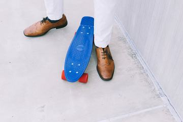 Man Standing Near Blue Skateboard