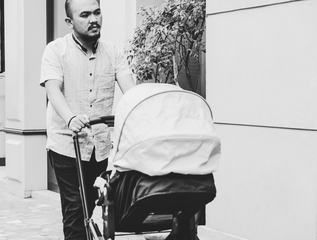 Father Walking with Baby in Stroller