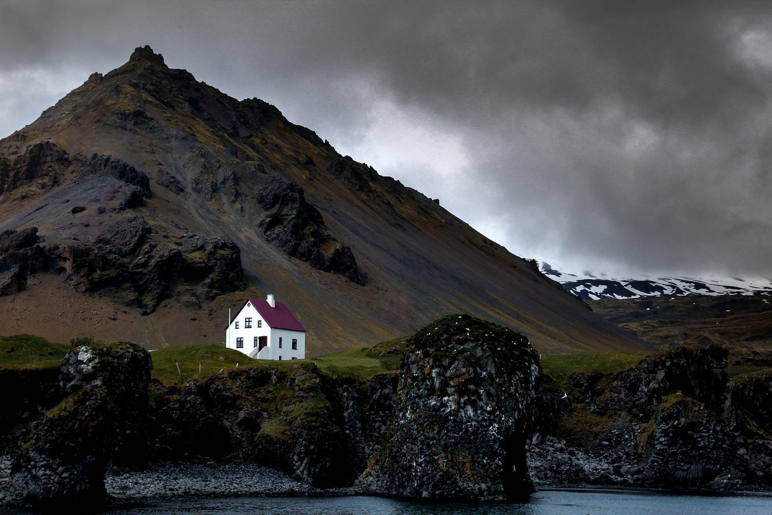 Fishing Village Arnarstapi at the Foot of the Volcano