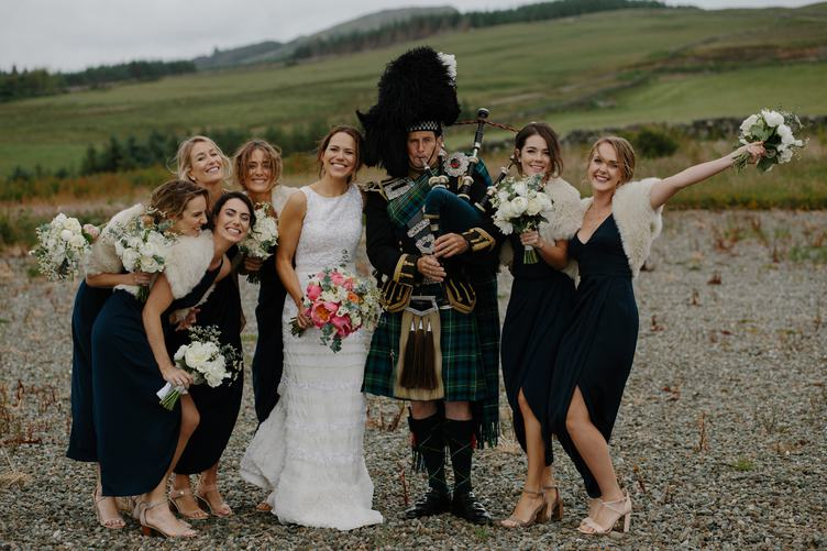 Beautiful Bride and Bridesmaids Posing with Bagpiper