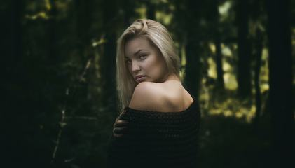 Sensual Portrait of Beautiful Young Woman in Forest