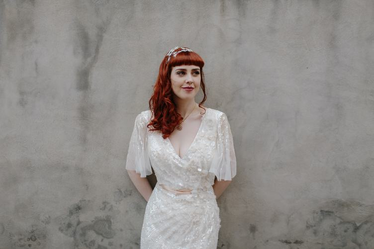 Bride with Red Hair Against Gray Wall