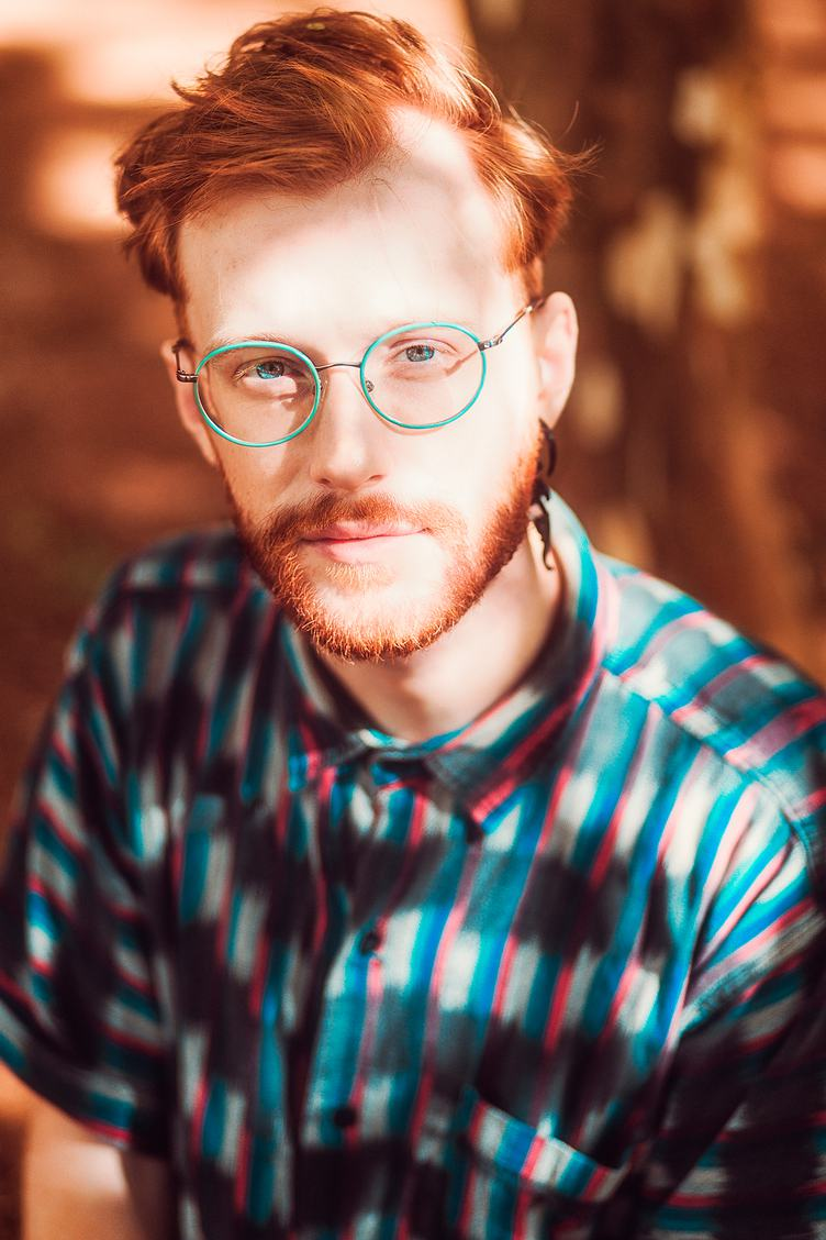 Redhead Guy Wearing Green Glasses