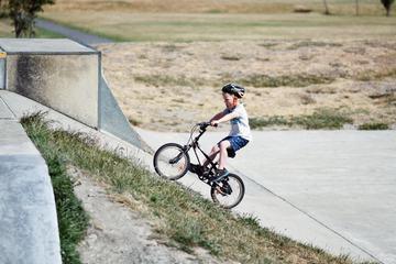 Little Boy Ride His Bike Uphill