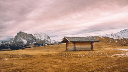 Small Wooden Hut in the Mountains