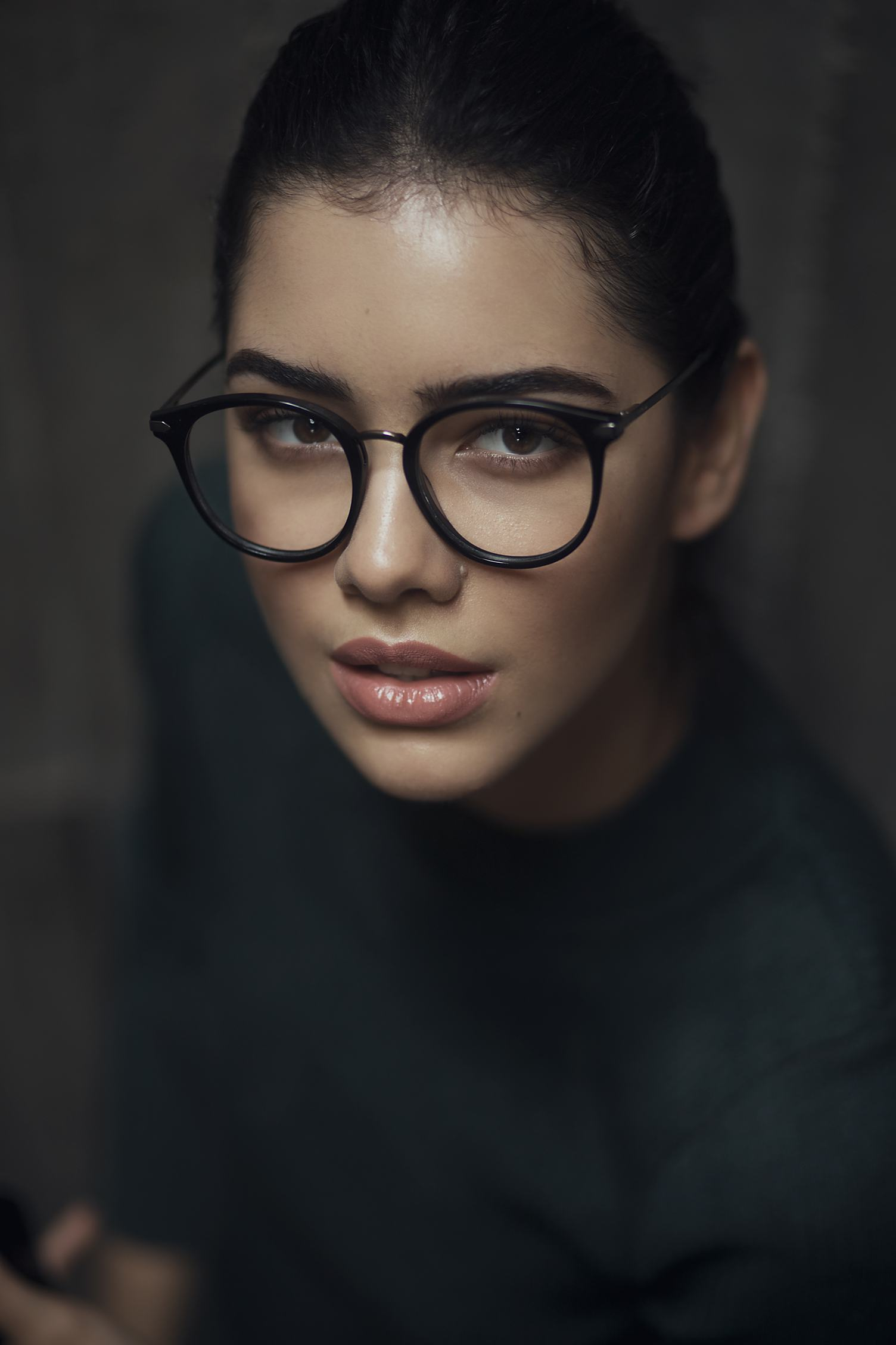 Portrait of Young Woman Wearing Retro Black Glasses