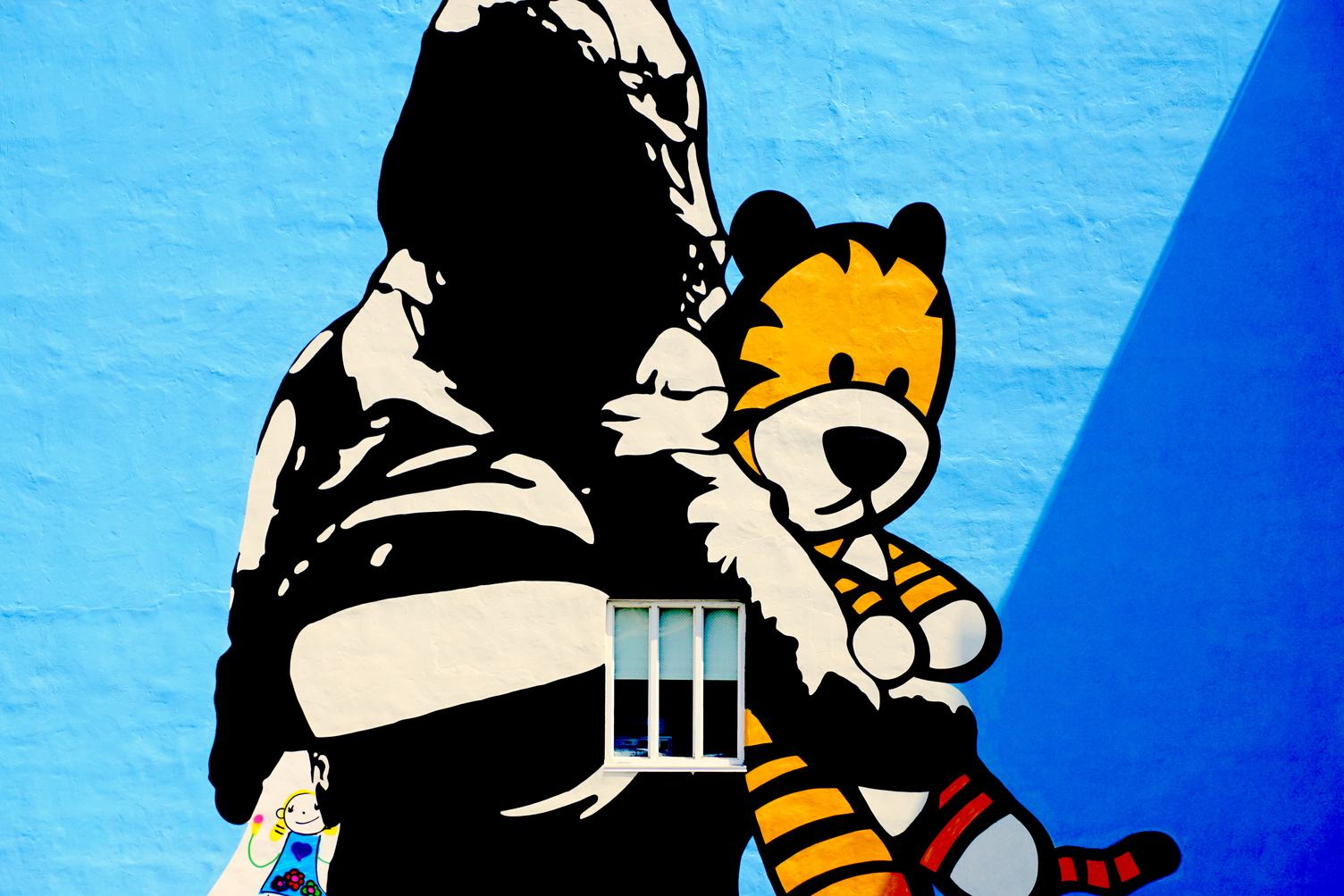 Mural of a Schoolgirl with Her Toy Tiger by Swiss Artist Bustart