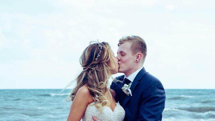 Wedding Couple Kissing on the Beach